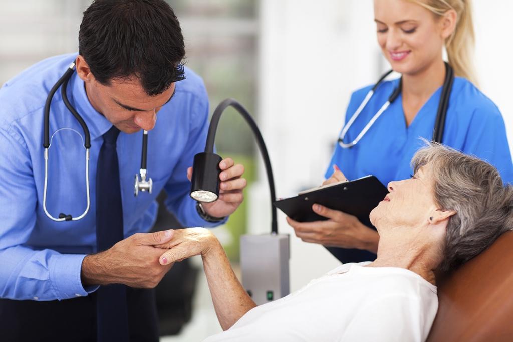 dermatologist examining senior woman's skin